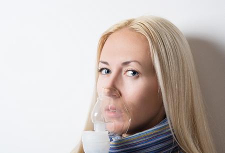 inhaler: girl treated with inhaler Stock Photo