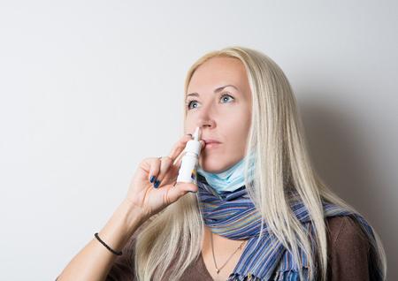 runny: girl treats a runny nose spray