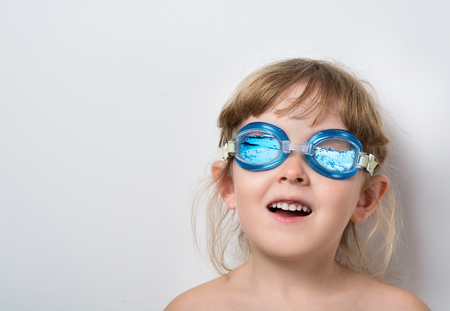 funny child in blue glasses for a scuba diving