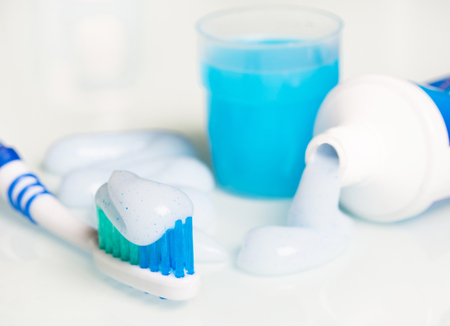 blue toothbrush with mouthwash and toothpaste