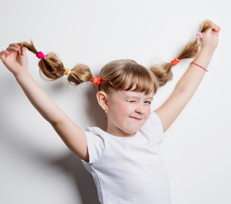 girl toying with pigtails Stock Photo