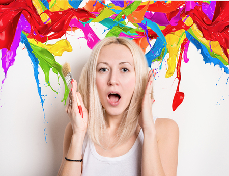 young woman in the midst of colorful splashes