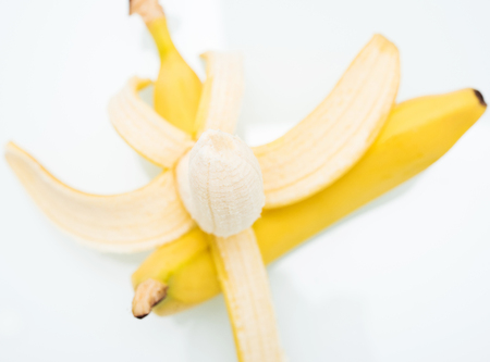 pair of ripe yellow bananas on a background Stock Photo