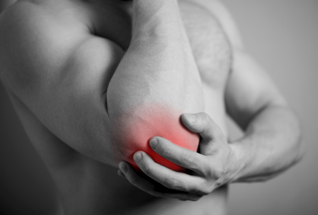 spasms: pain in the elbow Stock Photo