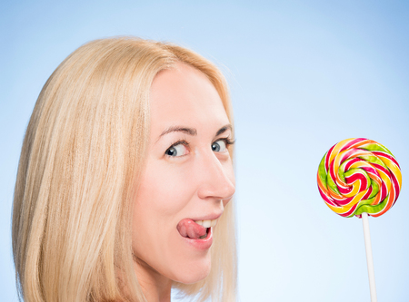 cheerful girl with a bright Lollipop Stock Photo