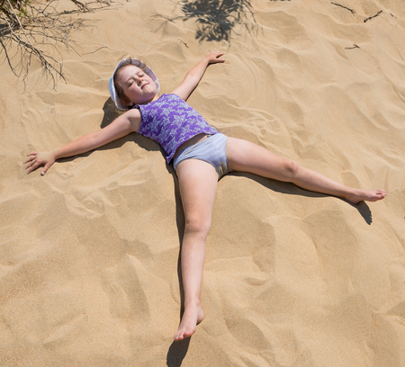little girl having fun on sandy beach