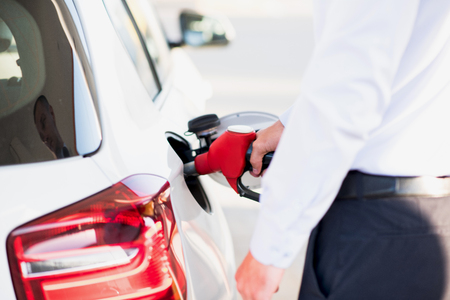 fuelling pump: gas station white vehicle Stock Photo
