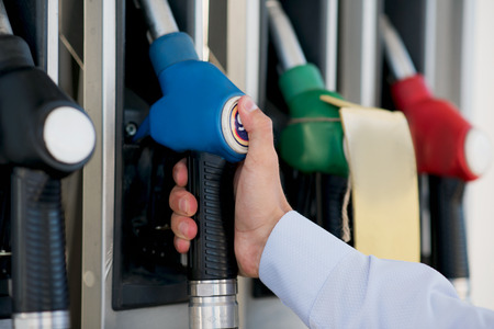 fuelling pump: hand at gas pistol