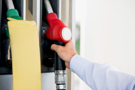fuelling pump: male hand at gas pistol