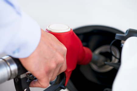 fuelling pump: process of refueling the car with petrol