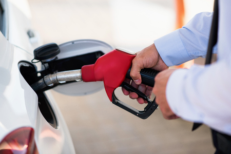 fuelling pump: process of refueling the car Stock Photo