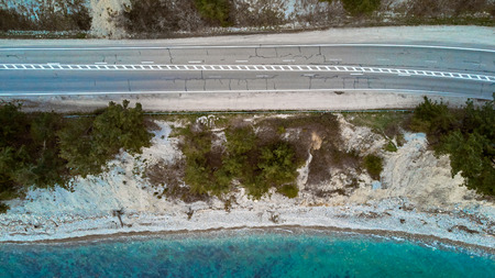 air view of the road by the sea with trucks