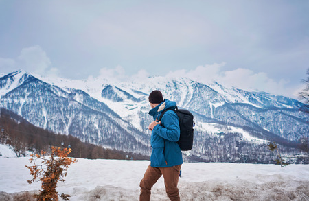 man with backpack in winter in the mountains 写真素材