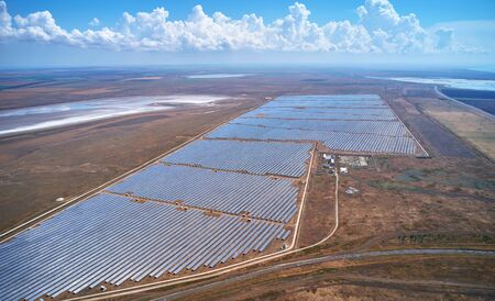 air view of the fields with solar panels