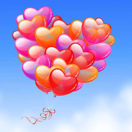 다채로운 심장 모양의 풍선 하늘에서