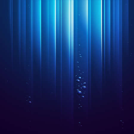 under the surface: Blue ocean from underwater with bubbles and with Light rays