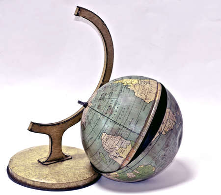 Global Disaster featuring a broken tin globe toy Stock Photo - 10086741