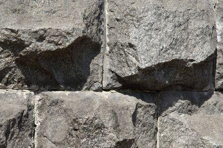 Gray granite wall on sun