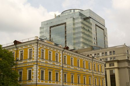 Old building on background of new building  Stock Photo - 7407870