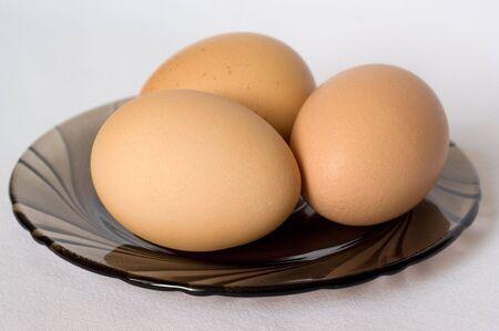 Chicken eggs on a plate 版權商用圖片