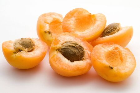 Half of Apricots on the white background