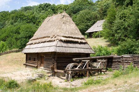 watermill: Ancient wooden ukrainian watermill Stock Photo