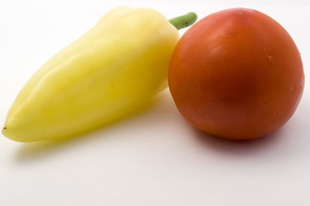 Fresh tomato and sweet peppers on a white background