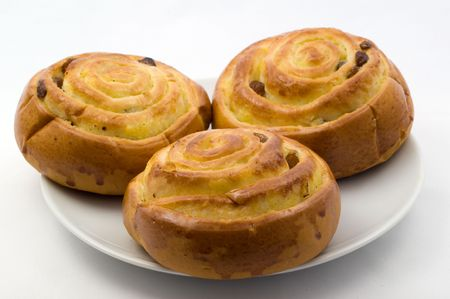sweet buns on a plate on a white background