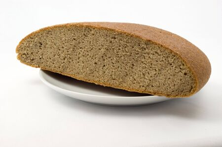 Bread on a plate on a white background