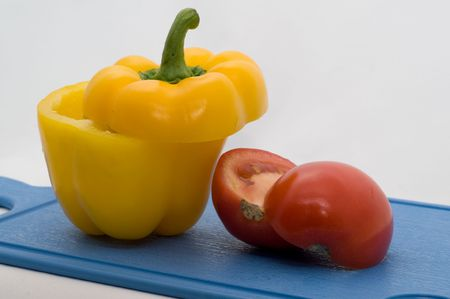 Fresh, colorful vegetable on a bord on a white background closeup