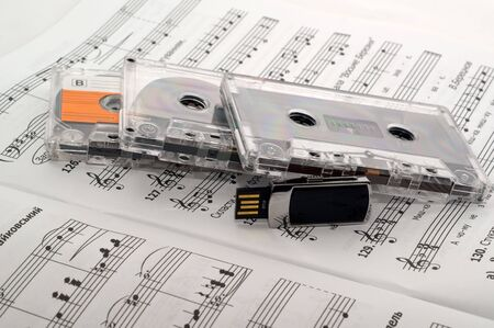 The music sheet tutorial solfeggio is a flash drive and cassette tape Stock Photo - 8051384