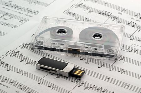 The music sheet tutorial solfeggio is a flash drive and cassette tape Stock Photo - 8051386