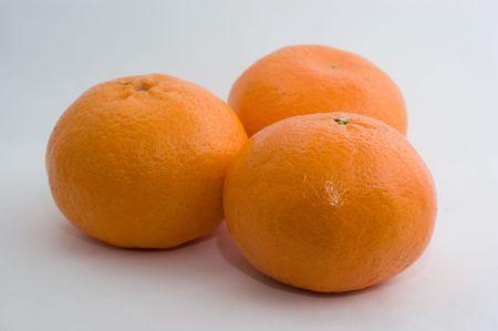 Drie grote mandarins op een witte achtergrond close-up Stockfoto - 8096891