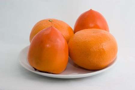 Cleared mandarin on a plate on a white background closeup Stockfoto - 8096884