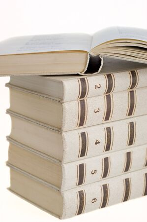 Six Books are stacked on a white background closeup 版權商用圖片