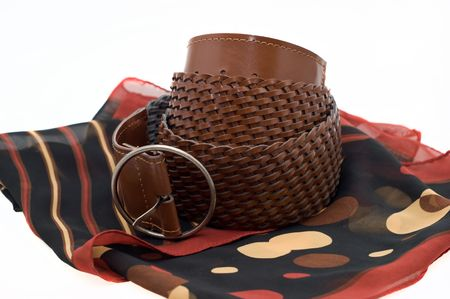 Womens braided brown leather belt with buckle at foulard on a white background photo