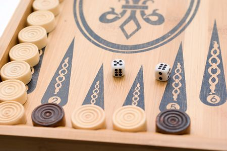 On the game board game backgammon chips and dice 5-6
