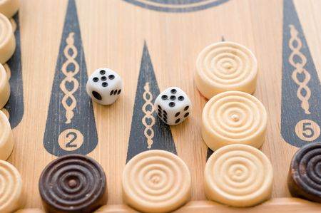 On the game board game backgammon chips and dice 5-5