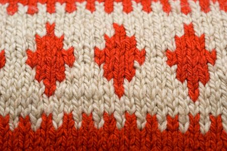 Texture background red and white manual knitted wool hank closeup