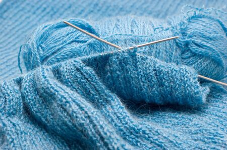 Manual knitting products from blue woolen yarns closeup Stok Fotoğraf