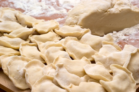 Traditional Ukrainian domestic dumplings filled with potatoes on the table closeup