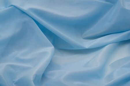 fabric texture: The background of textured blue synthetic fabric closeup
