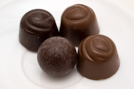 stuffing: Chocolate candies with stuffing on a white backgrounds closeup