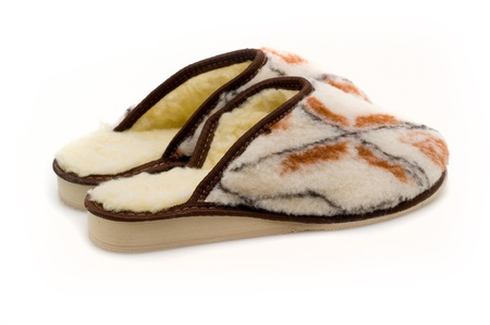 Ukrainian traditional leather slippers with sheep fur with ornaments Banco de Imagens