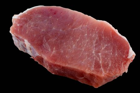 loin chops: Fresh pork loin chops isolation on a black background closeup Stock Photo