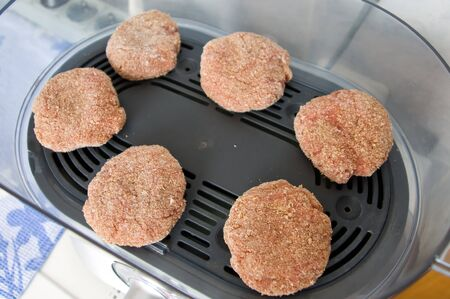 Meat patties are cooked by steaming in the kitchen Banco de Imagens