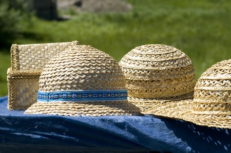 Straw hats are handmade with ornaments