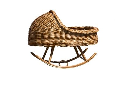 Baby cradle made by weaving willow wine in isolation Imagens