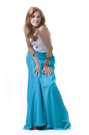 Portrait of a  beautifulgirl in a long skirt on a white background Stock Photo