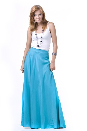 long: Portrait of a  beautifulgirl in a long skirt on a white background Stock Photo